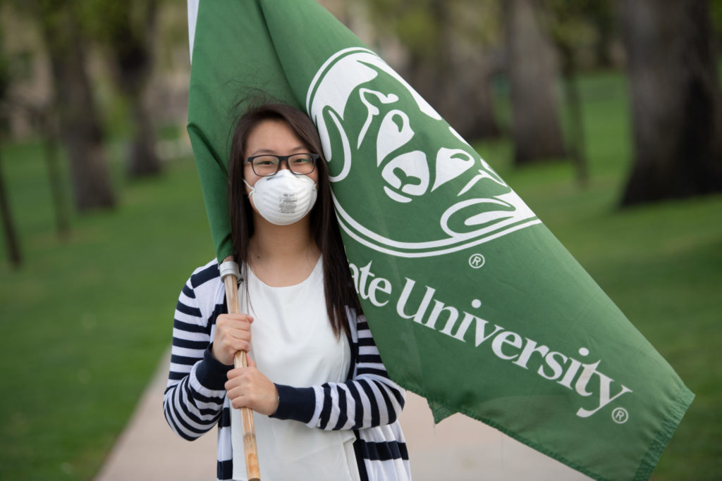 Girl with mask and CSU flag on the Oval