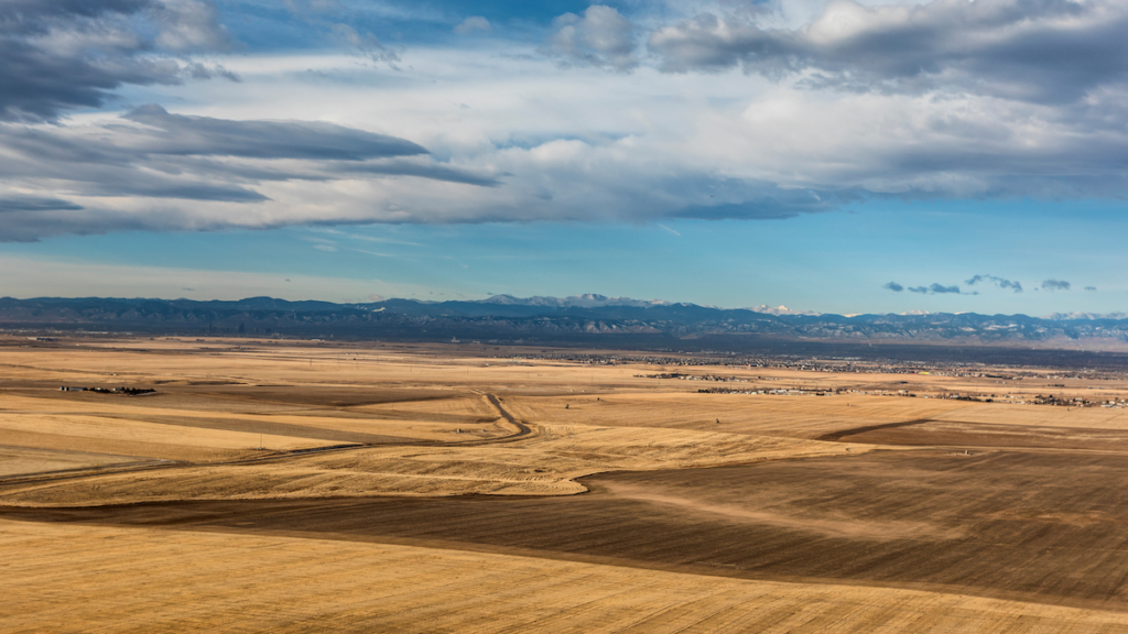 Aerial view of fields and mountains.